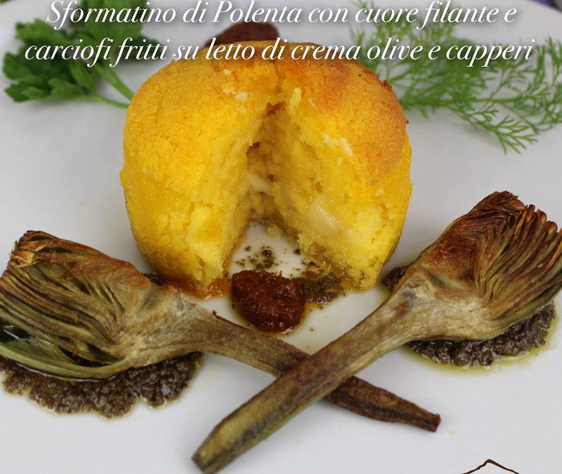 Sformatino di Polenta con cuore filante e carciofi fritti su letto di crema olive e capperi